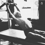 Joseph Pilates doing Teaser warm up on the Cadillac